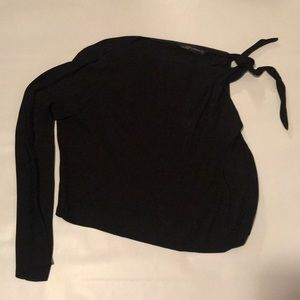 Black top with one sleeve.  Size small